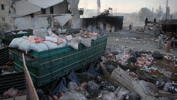 Остаци хуманитарног конвоја погођеног у ваздушном нападу у близини сиријског Алепа - Sputnik Србија