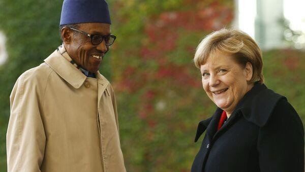 Predsednik Nigerije Mahamadu Buhar i Angela Merkel. - Sputnik Srbija