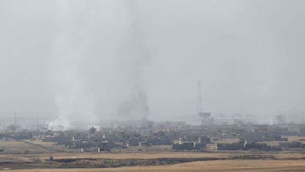 Dim u Mosulu nakon sukoba Pešmegri iračkih kurda i terorista DAEŠ-a, Irak - Sputnik Srbija