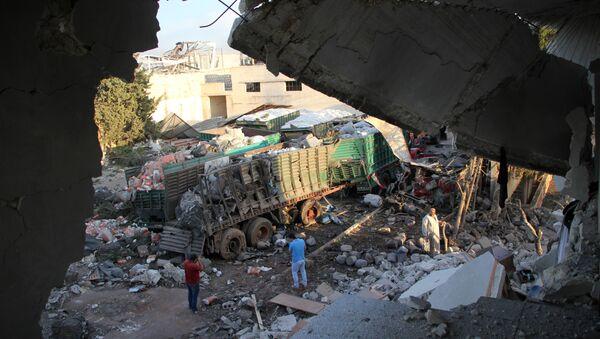 Расути пакети са хуманитарном помоћи на западу сиријског Алепа, дан након напада на хуманитарни конвој - Sputnik Србија