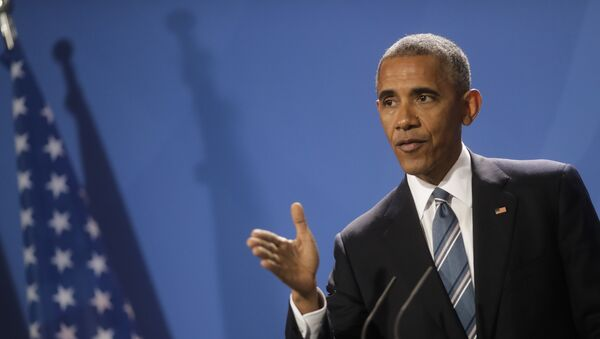 Амерички председник Барак Обама на конференцији за медије након састанка са немачком канцеларком Ангелом Меркел у Берлину - Sputnik Србија