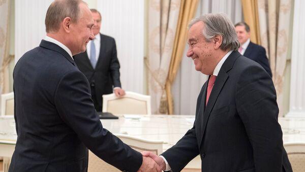 Ruski predsednik Vladimir Putin i generalni sekretar UN Antonio Gutereš - Sputnik Srbija