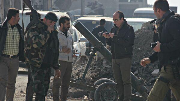 Сиријски војник после ослобађања Алепа, Сирија - Sputnik Србија