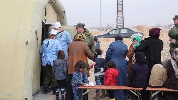 Ukazivanje pomoći u privremenom smeštaju za izbeglice Džibrin u Alepu - Sputnik Srbija