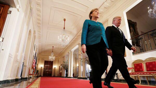 Председника САД Доналд Трамп и канцеларка Немачке Ангела Меркел у Вашингтону - Sputnik Србија