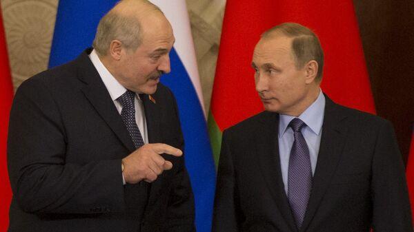 Председник Белорусије Александар Лукашенко и председник Русије Владимир Путин - Sputnik Србија
