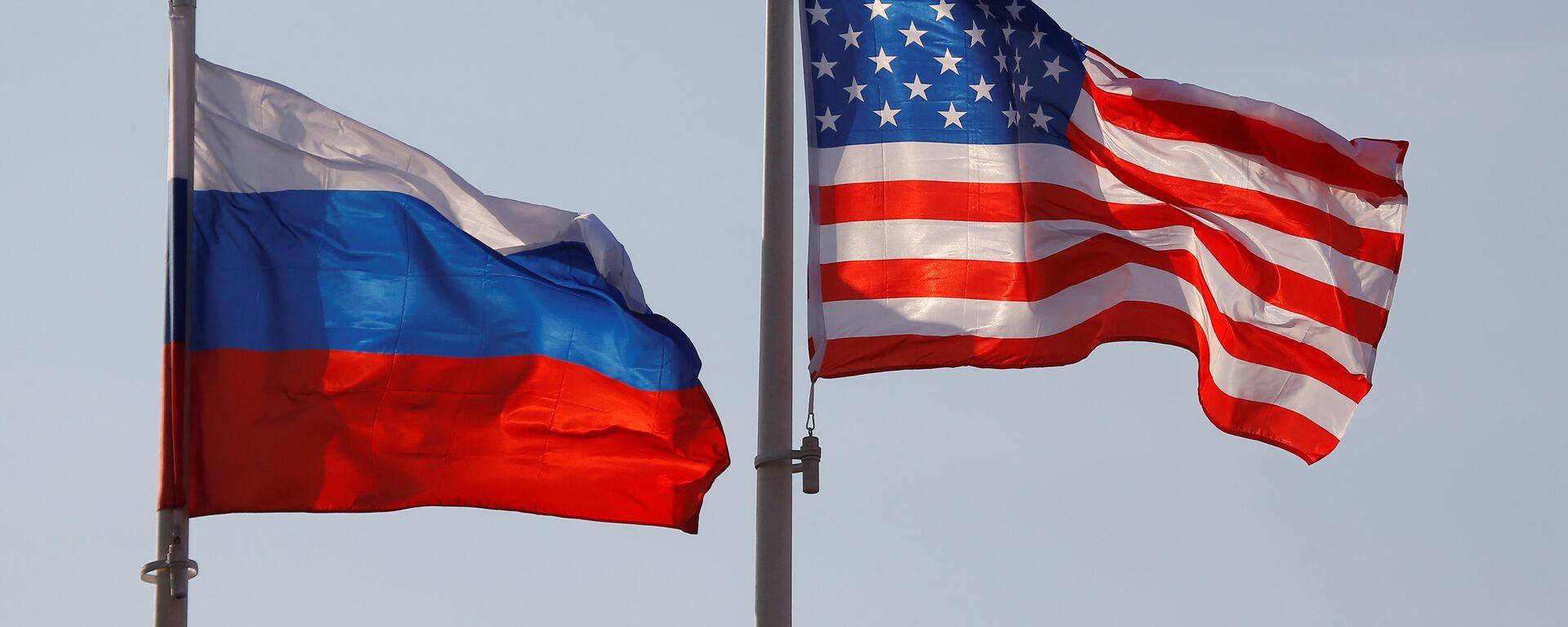 Zastave Rusije i SAD na međunarodnom aerodromu Vnukovo u Moskvi - Sputnik Srbija, 1920, 28.07.2021