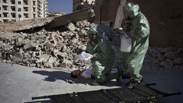 Волонтери учествују у симулацији реаговања на хемијски напад у Алепу - Sputnik Србија