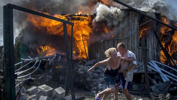 Crni dani Ukrajine: Rat i tuga kroz objektiv Sputnjikovog reportera - Sputnik Srbija