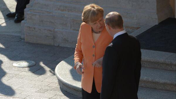 Немачка канцеларка Ангела Меркел и председник Русије Владимир Путин на састанку Г20 - Sputnik Србија