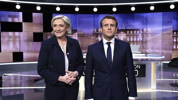 Kandidati za predsednika Francuske Marin le Pen i Emanuel Makron - Sputnik Srbija