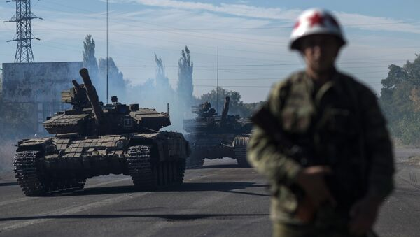 Повлачење тешког наоружања са линије додира у самопроглашеној Луганској Народној Републици - Sputnik Србија