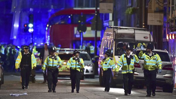 Police officers on Borough High Street as police are dealing with an incident on London Bridge in London, Saturday, June 3, 2017. - Sputnik Србија