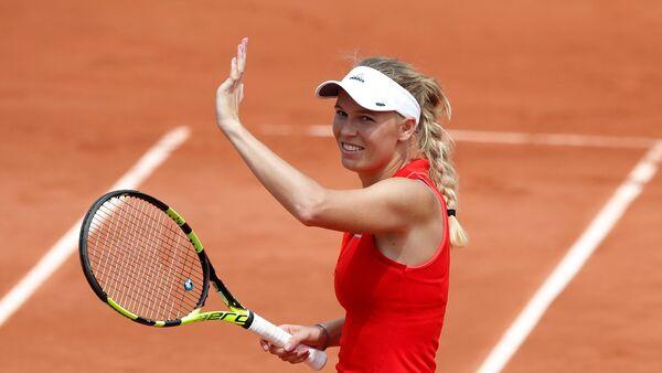 Danska teniserka Karolina Voznjacki proslavlja pobedu nakon meča protiv Australijanke Džejmi Furlis - Sputnik Srbija