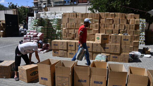 Priprema i podela humanitarne pomoći fonda Ahmeta Kadirova za porodice poginulih vojnika sirijske armije u Damasku - Sputnik Srbija