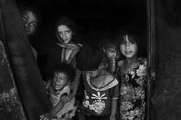 """""""Nemi krik"""" – rad Šahnevaza Hana iz Bangladeša. Deca koja žive u gradu Lehu u Indiji. - Sputnik Srbija"""
