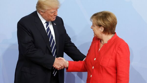 Председник САД Доналд Трамп и немачка канцеларка Ангела Меркел на почетку самита Г20 у Хамбургу - Sputnik Србија
