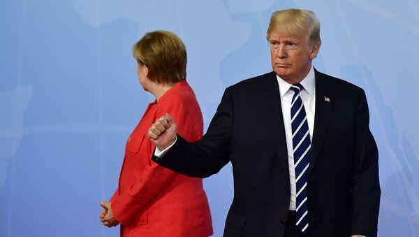 Nemačka kancelarka Angela Merkel i predsednik SAD Donald Tramp na otvaranju samita G20 u Hamburgu - Sputnik Srbija
