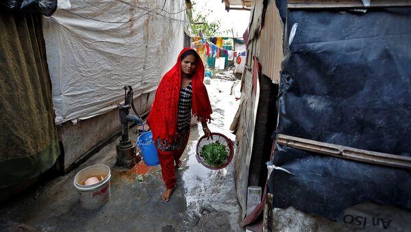 Žena iz naroda Rohindža u izbegličkom kampu u Nju Delhiju - Sputnik Srbija