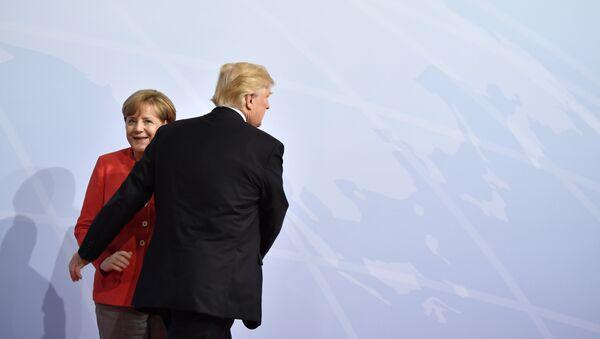 Немачка канцеларка Ангела Меркел и председник САД Доналд Трамп на самиту Г20 у Хамбургу - Sputnik Србија