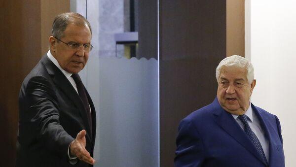 Министри спољних послова Русије и Сирије, Сергеј Лавров и Валид Муалем на састанку у Сочију - Sputnik Србија