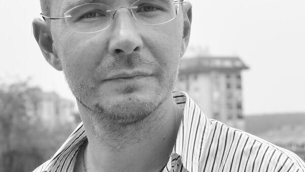 Ruski pesnik, prevodilac i kulturolog Oleg Komkov - Sputnik Srbija