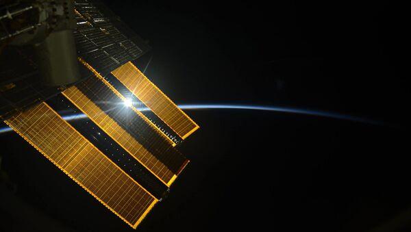 Svitanje sa Međunarodne svemirske stanice, fotografija kosmonauta Sergeja Rjazanskog - Sputnik Srbija