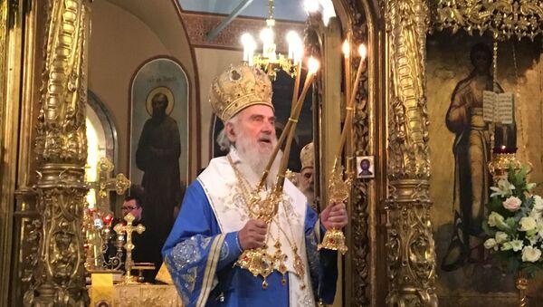 Патријарх српски Иринеј служи литургију у Цркви апостола Петра и Павла у Москви. - Sputnik Србија