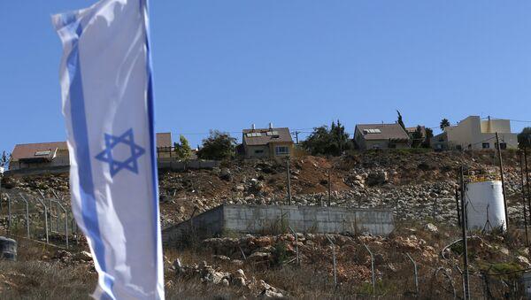 Izraelska zastava u jevrejskom naselju Šilo na palestinskoj Zapadnoj obali - Sputnik Srbija