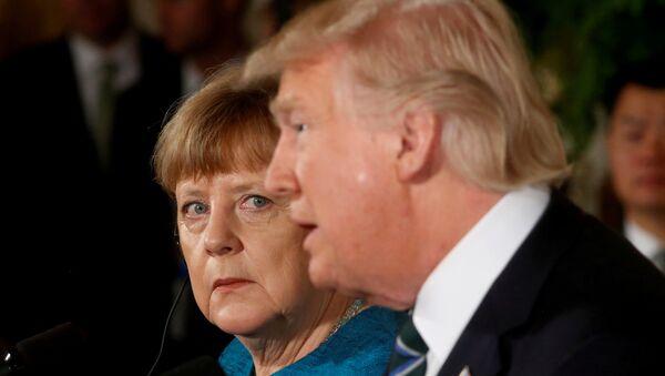 Немачка канцеларка Ангела Меркел и председник САД Доналд Трамп током заједничке конференције за медије у Белој кући - Sputnik Србија