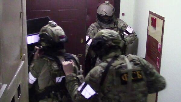 Припадници ФСБ током операције хапшења терористичке групе у Москви - Sputnik Србија