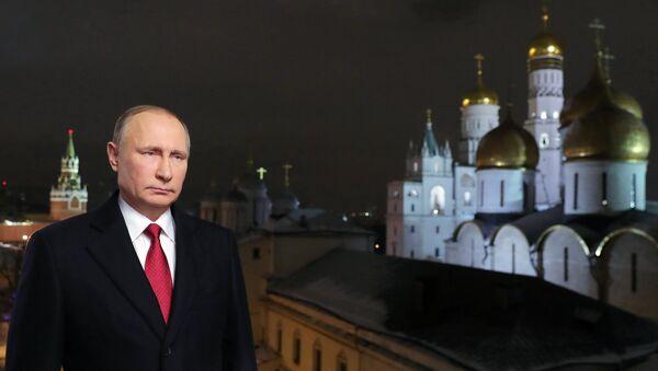 Predsednik Rusije Vladimir Putin tokom novogodišnje čestitke građanima  - Sputnik Srbija
