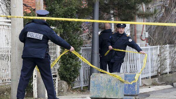 Косовски полицајци на месту где је убијен Оливер Ивановић у Косовској Митровици. - Sputnik Србија