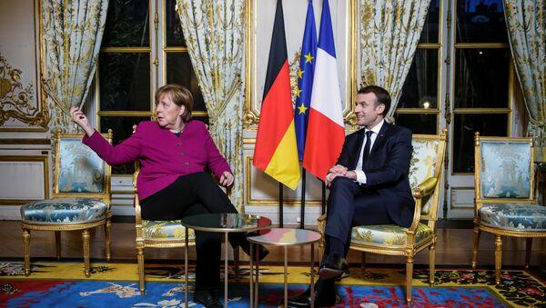 Angela Merkel i Emanuel Makron u Jelisejskoj palati u Parizu. - Sputnik Srbija