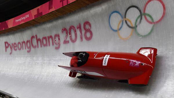 Швајцарске олимпијке Сабина Хафнер и Рахел Ребсамен током такмичења у бобу на Зимским олимпијским играма 2018. у Пјонгчангу - Sputnik Србија