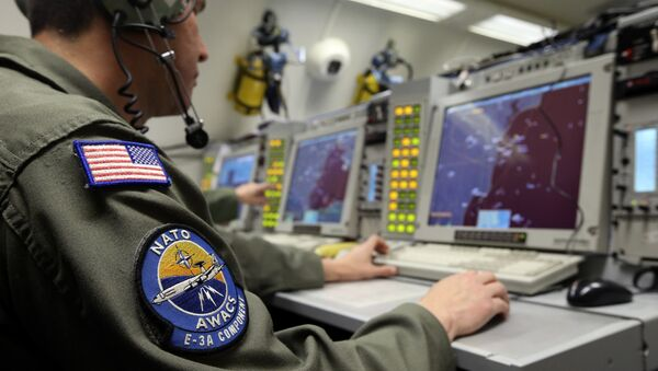 A controller monitors is seen screening aboard a NATO AWACS (Airborne Warning and Control Systems) aircraft during a surveillance flight over Romania in this April 16, 2014. - Sputnik Srbija