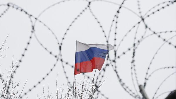 Руска застава иза бодљикаве жице - Sputnik Србија