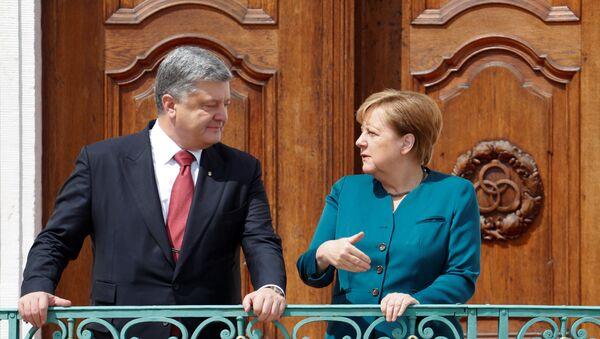 Predsednik Ukrajine Petro Porošenko i kanclerka Nemačke Angela Merkel - Sputnik Srbija