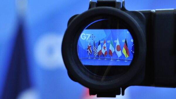 Flags are seen in a camera screen at the G7 summit (file) - Sputnik Srbija