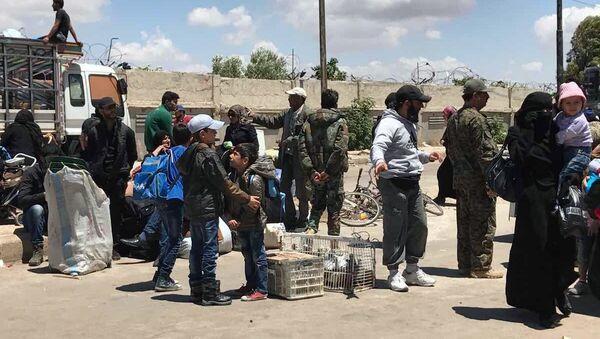 Последња етапа извођења милитаната из четврти Ел Ваер у сиријском Хомсу - Sputnik Србија