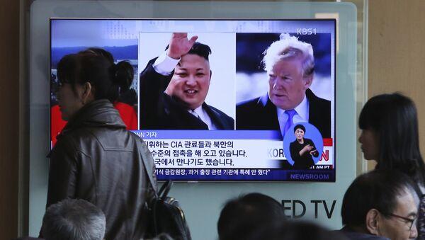 Ким Џонг УН и Доналд Трамп - Sputnik Србија