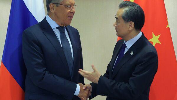 Министри спољних послова Русије и Кине, Сергеј Лавров и Ванг Ји - Sputnik Србија
