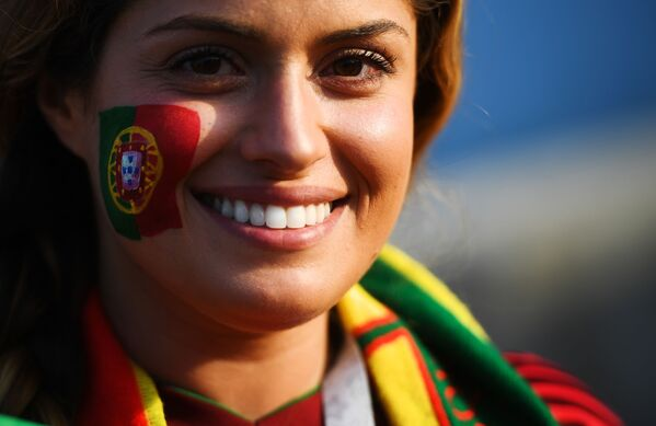 A fan of the Portuguese national team before the start of a group stage match between Portugal and Spain. - Sputnik Србија
