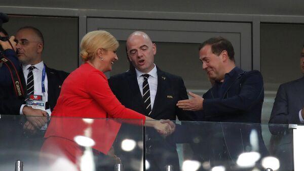 Kolinda Gabro Kitarović Đani Infantino i Dmitrij Medvedev na stadionu u Sočiju - Sputnik Srbija