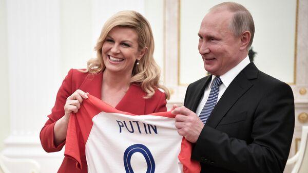 Председница Хрватске Колинда Грабар Китаровић и председник Русије Владимир Путин - Sputnik Србија