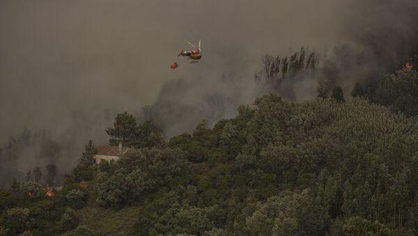 Гашење пожара на југу Португалије - Sputnik Србија