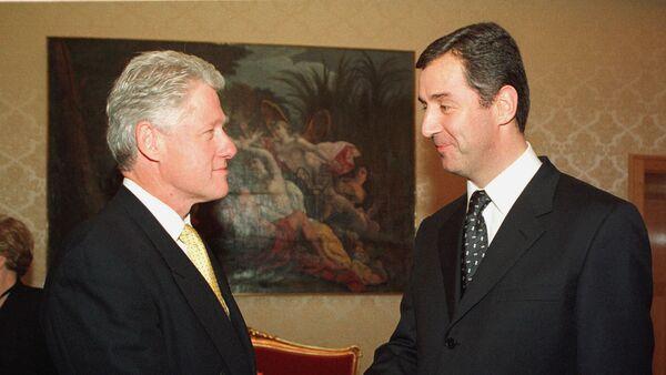 Амерички председник Бил Клинтон и председник Црне Горе Мило Ђукановић током састанка у Љубљани 21. јуна 1999. - Sputnik Србија