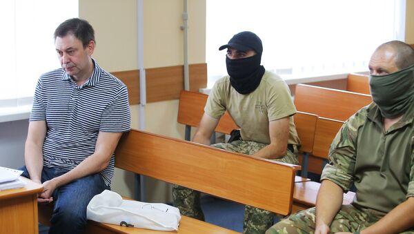 Urednik portala RIA Novosti Ukrajina, Kiril Višinski, u sudnici apelacionog suda Hersonske oblasti Ukrajine - Sputnik Srbija