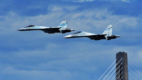 Вишенаменски ловци Су-35 и Су-30М2 током тренажног лета у оквиру припреме за церемонију отварања Источног економског форума у Владивостоку - Sputnik Србија