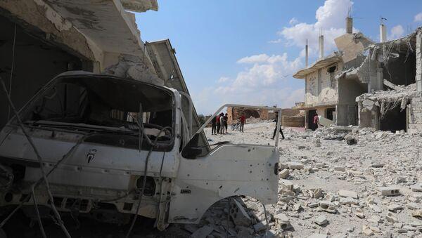 Razrušene zgrade nakon bombardovanja grada El Habit na jugu provincije Idlib u Siriji - Sputnik Srbija